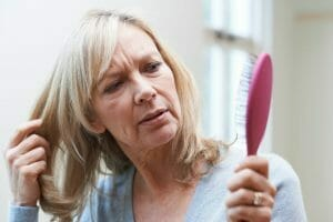 woman with hormone issues losing hair
